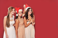 Girls with a glass of champagne meet new year Royalty Free Stock Images