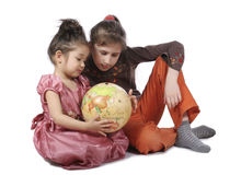 Girls with globe Royalty Free Stock Photography