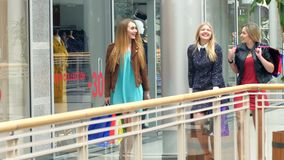 Girls go along and shop talk at the same time. Shopping, Blonde girl all dressed in beautiful dresses stock video footage