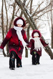Girls go on deep snow Royalty Free Stock Photography