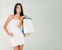 Girls goes shopping. Stock Photos