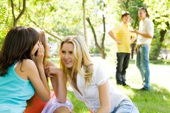 Girls gossiping Stock Photos