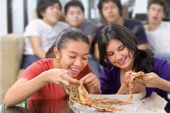 Girls got the first chance to eat pizza Stock Photo