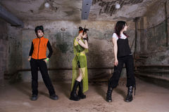 Girls of goth. In a gloomy, dirty, terrible cellar Stock Photos