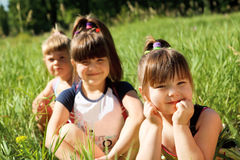 Girls in grass Royalty Free Stock Photography