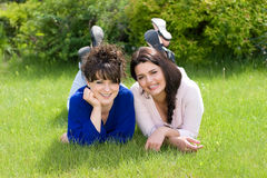 Girls on the grass Stock Photos