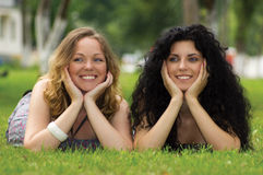 Girls on grass Royalty Free Stock Image