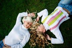 Girls in grass Stock Image