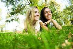 Girls on a green glade Stock Image