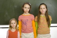 Girls at greenboard Stock Photo