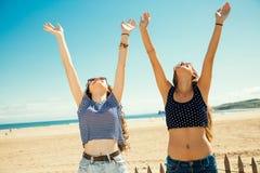 Girls greeting the sun Stock Photo