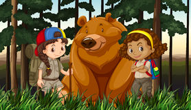 Girls and grizzly bear in the jungle Royalty Free Stock Photo