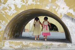 Girls In the Grunge Archway Royalty Free Stock Images