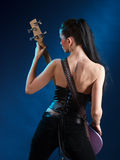 Girls with guitar from back Royalty Free Stock Images