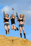Girls with gun Royalty Free Stock Photo