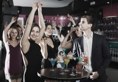 Girls and guys  dancing on party. With cocktails in the club Royalty Free Stock Image