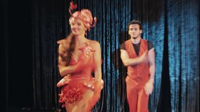 Girls and guys in sea themed red shrimp carnival costumes dancing on scene stock footage