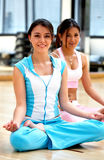 Girls at the gym - yoga Stock Photo