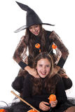 Girls in halloween costume Stock Images