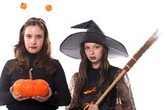Girls in halloween costumes Royalty Free Stock Photos