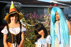 Girls in Halloween Costumes. Three girls dressed up in their Halloween costumes royalty free stock images