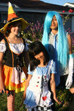 Girls in Halloween Costumes. Three girls dressed up in their Halloween costumes stock photos