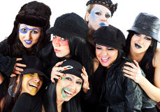 Girls halloween smiling. Seven girls prepared for halloween hugging and smiling Stock Photos
