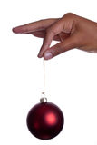 Girls hand holding bauble Stock Images