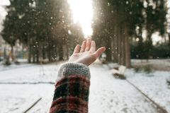 Girls hand on nature background with snow Royalty Free Stock Image