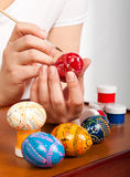 Girls hand paint a several Easter eggs Royalty Free Stock Photo