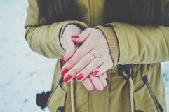Girls hands in cold in winter day. Girls hands цшер red manicure in cold in winter day Royalty Free Stock Images