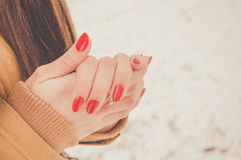 Girls hands in cold in winter day. Girls hands цшер red manicure in cold in winter day Stock Photography