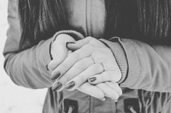 Girls hands in cold in winter day. Girls hands цшер red manicure in cold in winter day Stock Photo