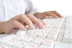 Girls hands on the computer keyboard Stock Photo