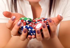 Girls hands holding a bunch of poker chips. (focus on front royalty free stock photos