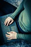 Girls hands on laptop keyboard, close up shot. Girls hands on laptop keyboard in the house, close up shot Stock Photography