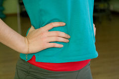 The girls hands in sportswear on the waist closeup Royalty Free Stock Photography
