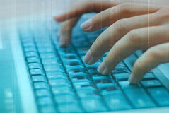 Girls hands typing on a laptop Royalty Free Stock Photos