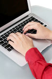 Girls hands typing on laptop Royalty Free Stock Photography