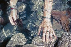 Girls hands under water. Stock Image