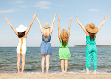 Girls with hands up on the beach Royalty Free Stock Photography