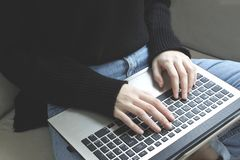 Girls hands working with laptop. stock images