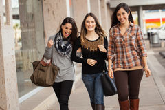 Girls hanging out and having fun at a mall Royalty Free Stock Photos