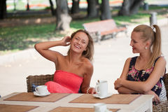 Girls has a rest in street cafe Stock Images