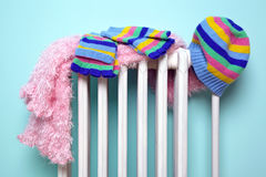 Girls hat scarf and gloves drying on a radiator Royalty Free Stock Photo