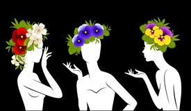 Girls in hats from flowers Royalty Free Stock Photos