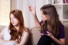 Girls have an argument. Two girlfriends have an argument and talking about problems royalty free stock photography