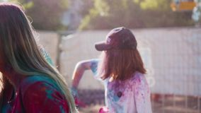 Girls have fun at the festival of colors Holi. Wonderful funny shots. stock footage