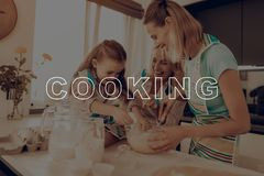 Girls Have Fun . Happy Family Enjoy Cooking . Girls Have Fun. Happy Family Enjoy Cooking. Woman Help Girl. Woman Prepare Dough. Happy Family Cooking royalty free stock images