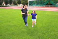 Girls have fun on stadium Royalty Free Stock Photography